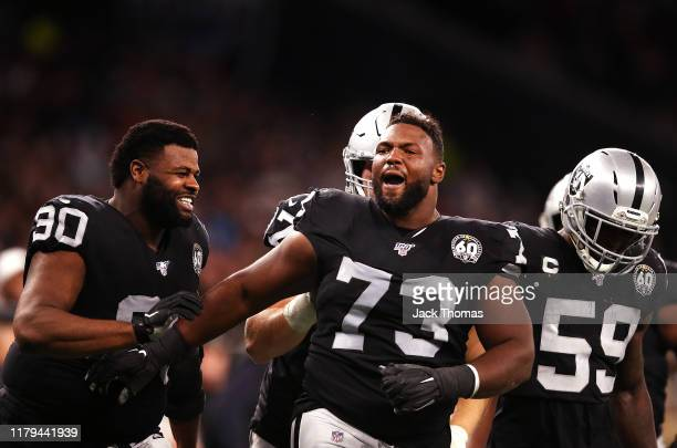 Maurice Hurst of the Oakland Raiders celebrates after sacking Chase Daniel of the Chicago Bears on the last play of the game during the match between...