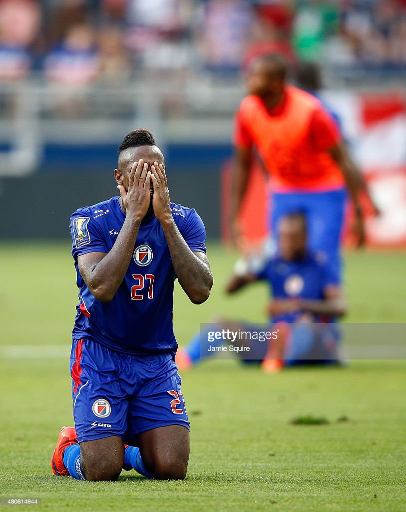 Maurice Jean Eudes #21 of Haiti prays after Haiti defeated Honduras 1-0 to win their 2015 CONCACAF Gold Cup match at Sporting Park on July 13, 2015 in Kansas City, Kansas.