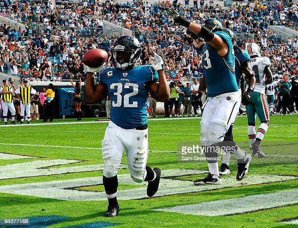 Maurice Jones-Drew of the Jacksonville Jaguars celebrates after scoring a touchdown during the game against the Miami Dolphins at Jacksonville...
