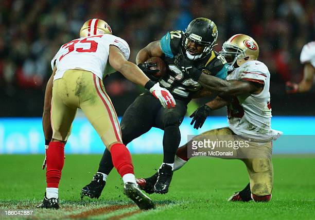Maurice JonesDrew of the Jacksonville Jaguars is tackled by Eric Reid of the San Francisco 49ers during the NFL International Series game between San...