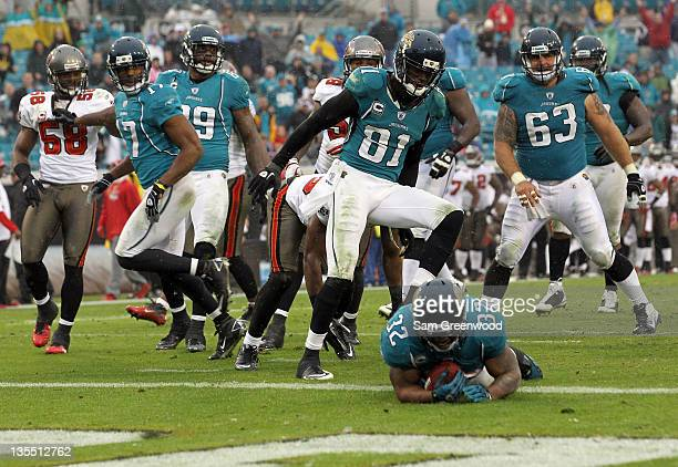 Maurice JonesDrew of the Jacksonville Jaguars runs for a touchdown during the game against the Tampa Bay Buccaneers at EverBank Field on December 11...