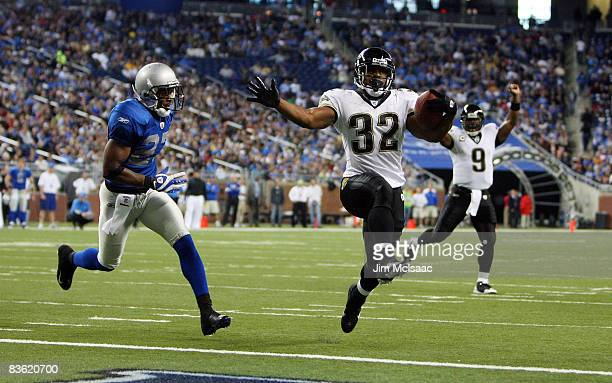 Maurice JonesDrew of the Jacksonville Jaguars runs in his first touchdown past Daniel Bullocks of the Detroit Lions on November 9 2008 at Ford Field...