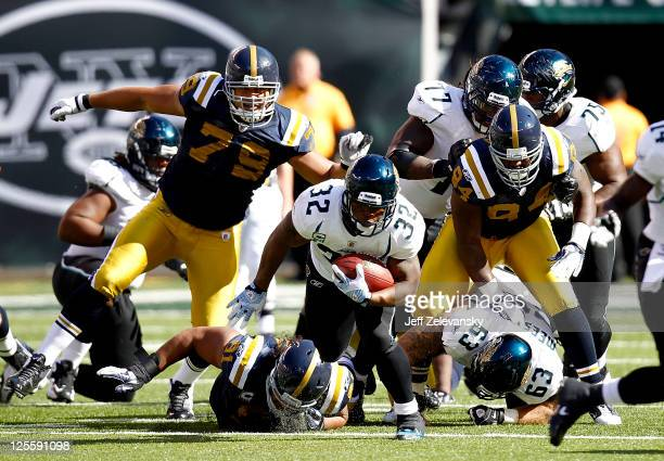 Maurice Jones-Drew of the Jacksonville Jaguars runs the ball during a game against the New York Jets at MetLife Stadium on September 18, 2011 in East...