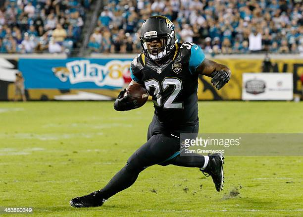 Maurice Jones-Drew of the Jacksonville Jaguars rushes for yardage during the game against the Houston Texans at EverBank Field on December 5, 2013 in...