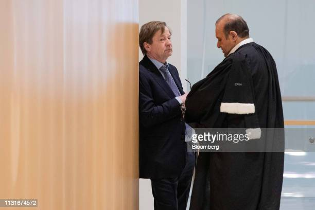 Maurice Lantourne a former lawyer for French businessman Bernard Tapie left speaks with Herve Temime lawyer in the hallway at Porte de Clichy...