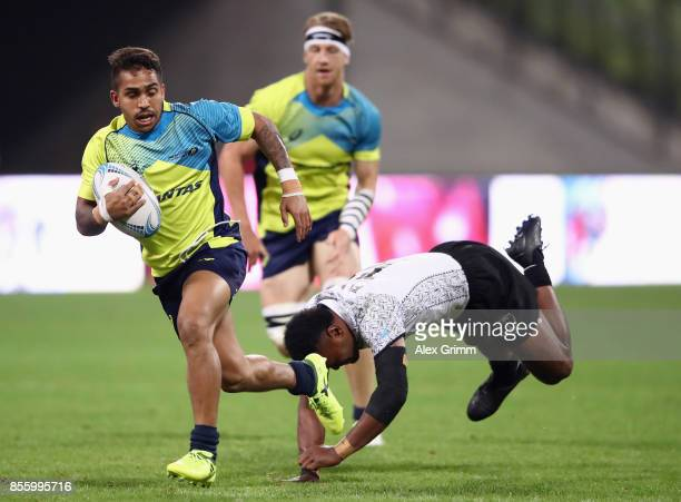 Maurice Longbottom of Australia eludes Amenoni Nasilasila of Fiji during the final between Fiji and Australia on Day 2 of the Rugby Oktoberfest 7s...