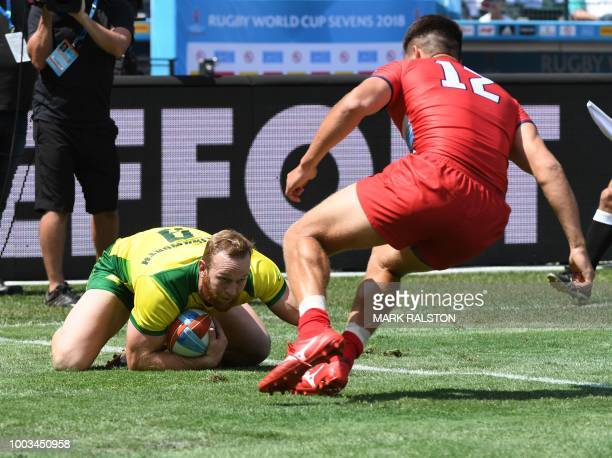 Maurice Longbottom of Australia scores a try as German Davydov of Russia fails to intercept during their Challenge quarter finals game at the Rugby...