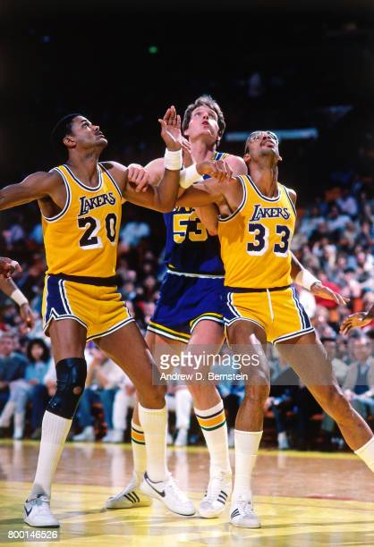 Maurice Lucas and Kareem AbdulJabbar of the Los Angeles Lakers box out against the Utah Jazz during a game played circa 1989 at the Great Western...