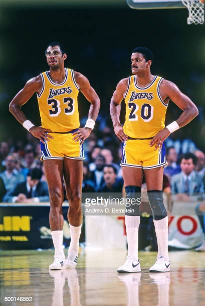 Maurice Lucas and Kareem AbdulJabbar of the Los Angeles Lakers during a game played circa 1989 at the Great Western Forum in Inglewood California...