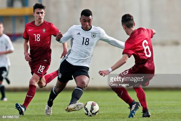 Maurice Malone of Germany U17 challenges André Almeida and Afonso Sousa of Portugal U17 during the U17 Algarve Cup Tournament Match between Portugal...