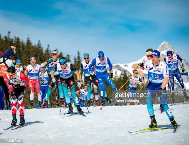 Maurice Manificat of France Francesco De Fabiani of Italy Dario Cologna of Swiss during FIS Nordic World Ski Championship Men 50 km Mass Start Free...