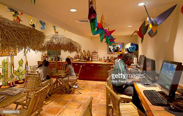 Maurice Miller of Brooklyn at the Tiki Room Internet Cafe on Rewards street at the Judge Rotenberg Center. The Judge Rotenberg Educational Center is...