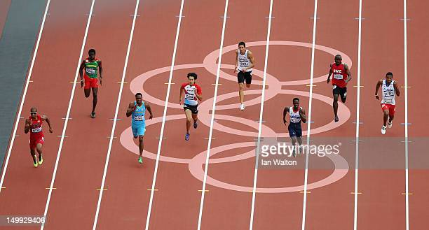 Maurice Mitchell of the United States and Christian Malcolm of Great Britain lead the pack during the Men's 200m Round 1 Heats on Day 11 of the...