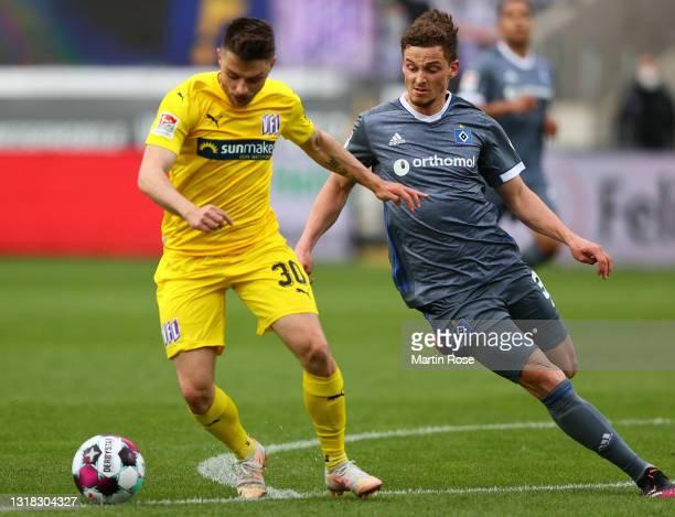 Maurice Multhaup of VfL Osnabrueck scores their team's second goal past Moritz Heyer of Hamburger SV during the Second Bundesliga match between VfL...
