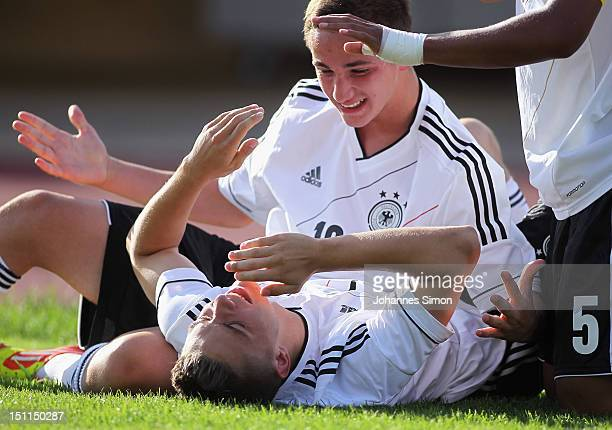 Maurice Multhaupt of Germany celebrates with teammate Donis Avdijaj after scoring their team's 3rd goal during the UEFA International Toto Cup 2012...