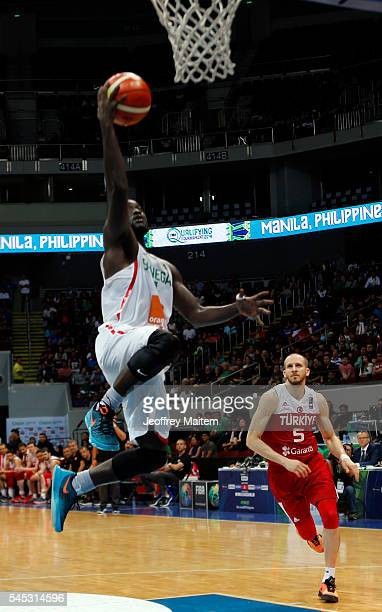 Maurice Ndour of Senegal lays the ball to the basket during the 2016 FIBA World Olympic Qualifying basketball Group A match between Turkey and...