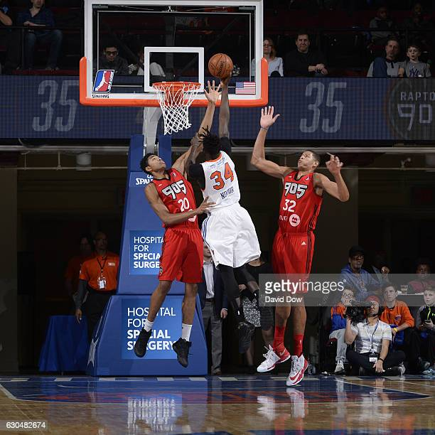 Maurice Ndour of the Westchester Knicks shoots the ball against Bruno Caboclo and Edy Tavares of the Raptors 905 at the Westchester County Center on...