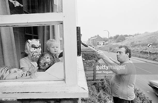Maurice Newton a miner on strike washes the windows of his home Newton was on strike in 1972 and 1974 and had been again since March 1984