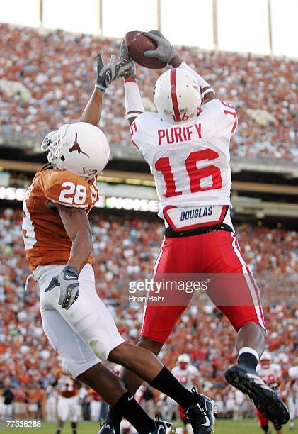 Maurice Purify of the Nebraska Cornhuskers grabs a touchdown pass late in the fourth quarter against cornerback Brandon Foster of the Texas Longhorns...