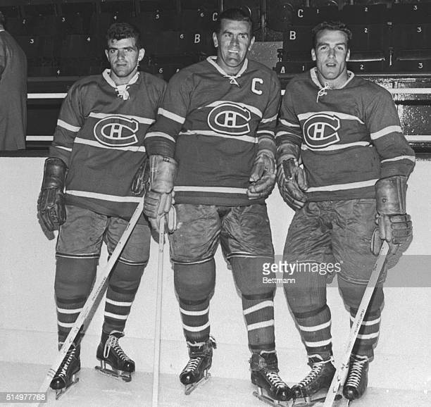 Maurice Richard hockey's highest scorer and vet star of NHL Montreal Canadiens with younger brothers Claude and Henri who'll man the Hab's forward...