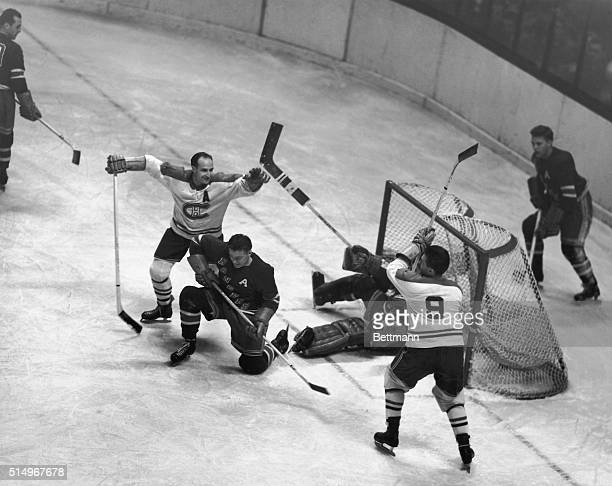 Maurice Richard of the Montreal Canadiens has just rammed the puck past goalie Chuck Rayner of the New York Rangers for a score during the first...