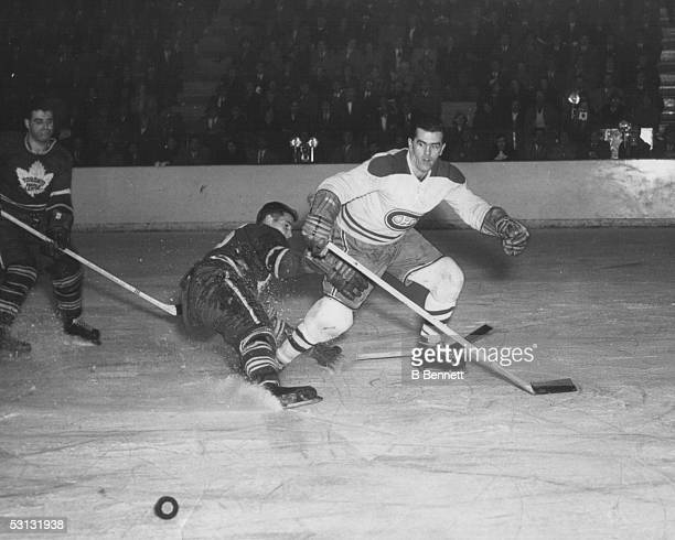 Maurice Richard of the Montreal Canadiens skates for the puck during an NHL game against the Toronto Maple Leafs circa 1950's at the Maple Leaf...