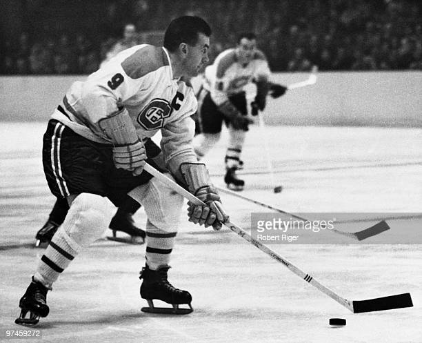 Maurice Rocket Richard of the Montreal Canadiens skates with the puck during a game circa 19561960 at the Montreal Forum in Montreal Quebec Canada