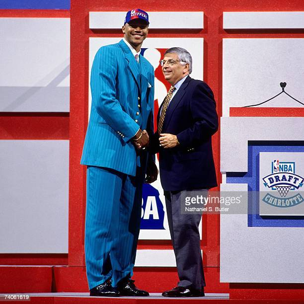 Maurice Taylor drafted by the Los Angeles Clippers shakes NBA Commissioner David Stern's hand during the 1997 NBA Draft on June 25, 1997 at the...