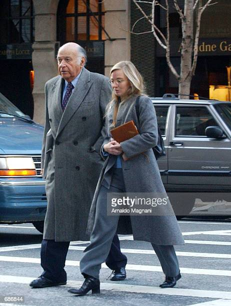 Maurice Tempelsman walks along Madison Avenue with his 33 year old girlfriend Alice Kimball Malone December 11 2001 in New York City