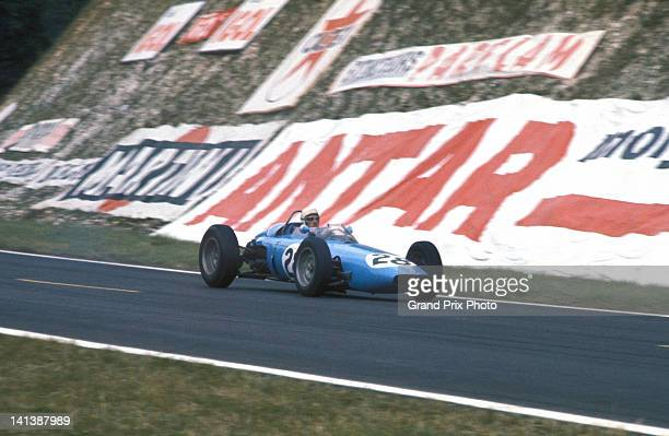 Maurice Trintignant of drives his privately entered BRM P57 BRM V8 during the French Grand Prix on 28th June 1964 at the RouenLesEssarts circuit in...