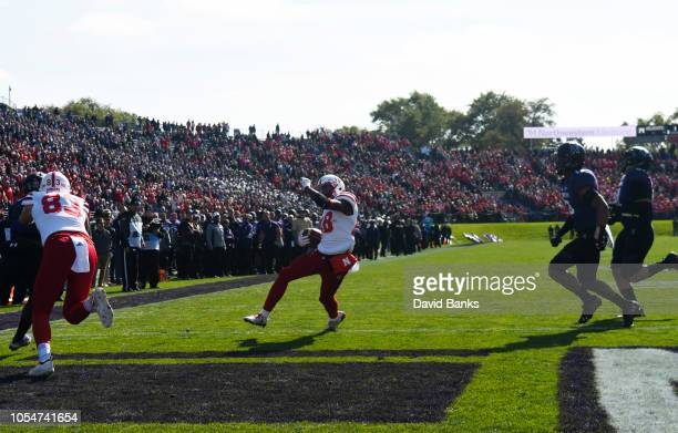Maurice Washington of the Nebraska Cornhuskers scores a touchdown against the Northwestern Wildcats during the second half on October 13 2018 at Ryan...