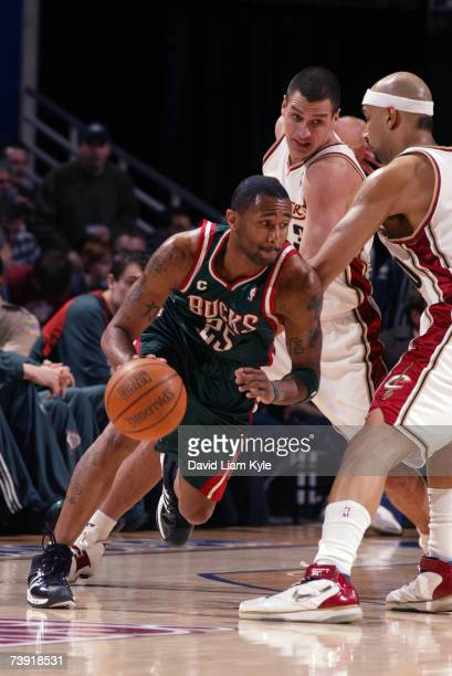 Maurice Williams of the Milwaukee Bucks drives around Drew Gooden of the Cleveland Cavaliers April 18, 2007 at The Quicken Loans Arena in Cleveland,...
