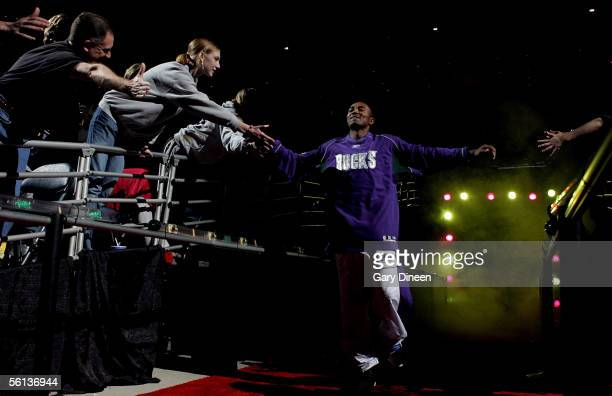 Maurice Williams of the Milwaukee Bucks greets fans as he comes out of the tunnel during player introductions against the Miami Heat during a NBA...
