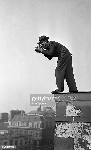 Maurice Zalewski photographing from the top roof of the newspaper Le Matin in Paris In 1937