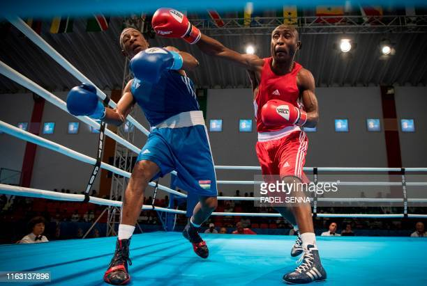 Maurice's Colin Luis Richarno and Lesotho's Mohlerepe Qhobosheane compete during the men's light boxing competition in 12th edition of the African...