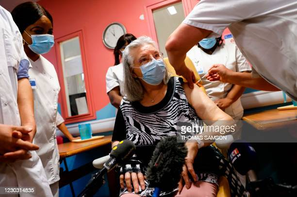 Mauricette, a French 78-year-old woman, receives a dose of the Pfizer-BioNTech Covid-19 vaccine at Rene-Muret hospital in Sevran, on the outskirts of...