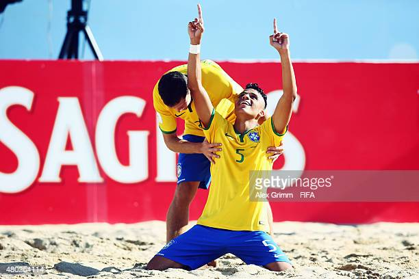 Mauricinho of Brazil celebrates his team's fifth goal with team mate Fernando Ddi during the FIFA Beach Soccer World Cup Portugal 2015 Group C match...