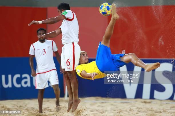 Mauricinho of Brazil makes an overhead kick against Ushel Al Araimi of Oman during the FIFA Beach Soccer World Cup Paraguay 2019 group D match...
