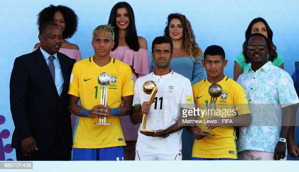 Mauricinho of Brazil pictured with the 'Adidas Silver Ball' award Mohammad Ahmadzadeh of Iran pictured with the 'Adidas Golden Ball' award and...