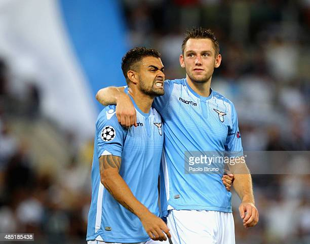 Mauricio and Stefan De Vrij of SS Lazio react after the UEFA Champions League qualifying round play off first leg match between SS Lazio and Bayer...