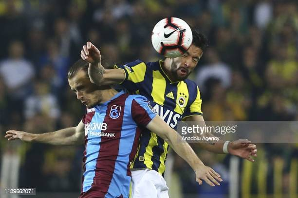 Mauricio Anibal Isla of Fenerbahce in action against Abdulkadir Parmak of Trabzonspor during Turkish Super Lig week 30 soccer match between...