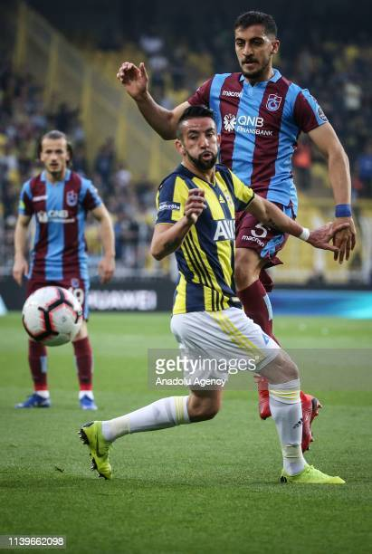 Mauricio Anibal Isla of Fenerbahce in action against Majid Hosseini of Trabzonspor during Turkish Super Lig week 30 soccer match between Fenerbahce...