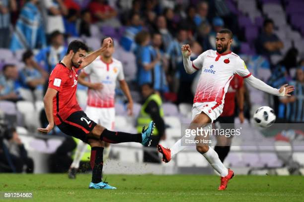 Mauricio Antonio of Urawa Red Diamonds and Ismail El Haddad of Wydad Casablanca compete for the ball during the FIFA Club World Cup UAE 2017 Match...