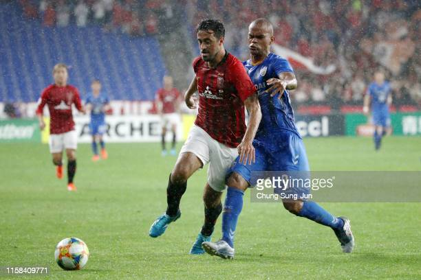 Mauricio Antonio of Urawa Red Diamonds and Junior of Ulsan Hyundai compete for the ball during the AFC Champions League round of 16 second leg match...