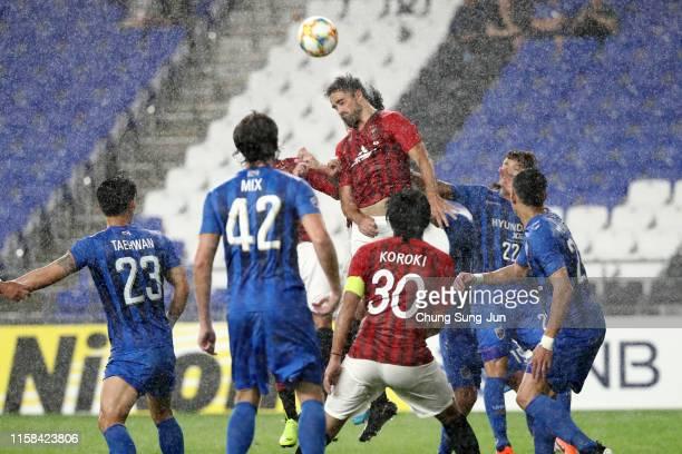 Mauricio Antonio of Urawa Red Diamonds heads the ball during the AFC Champions League round of 16 second leg match between Ulsan Hyundai and Urawa...