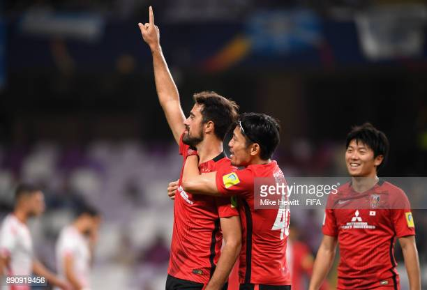 Mauricio Antonio of Urawa Reds celebrates scoring the 3rd Urawa Reds goal with team mates during the FIFA Club World Cup UAE 2017 fifth place playoff...
