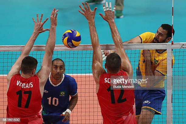 Mauricio Borges of Brazil spikes the ball during the men's qualifying volleyball match between the Brazil and Canada on Day 4 of the Rio 2016 Olympic...