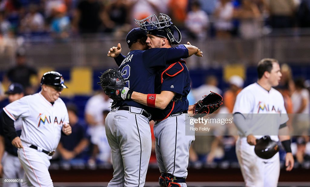 Mauricio Cabrera #62 of the Atlanta Braves hugs Tyler Flowers #25 after the game against the Miami Marlins at Marlins Park on September 23, 2016 in Miami, Florida.