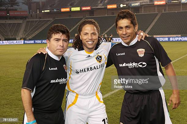 Mauricio Cienfuegos Cobi Jones and Jorge Campos formerly of the Los Angeles Galaxy pose for a photo prior to the celebrity soccer match against...