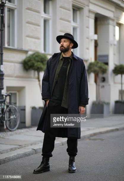 Mauricio Corridan wearing Coat Jacquemus Shirt Acne studios Hat Lackofcolor TShirt Acne Studios Shoes Dr Martens on March 20 2019 in Berlin Germany